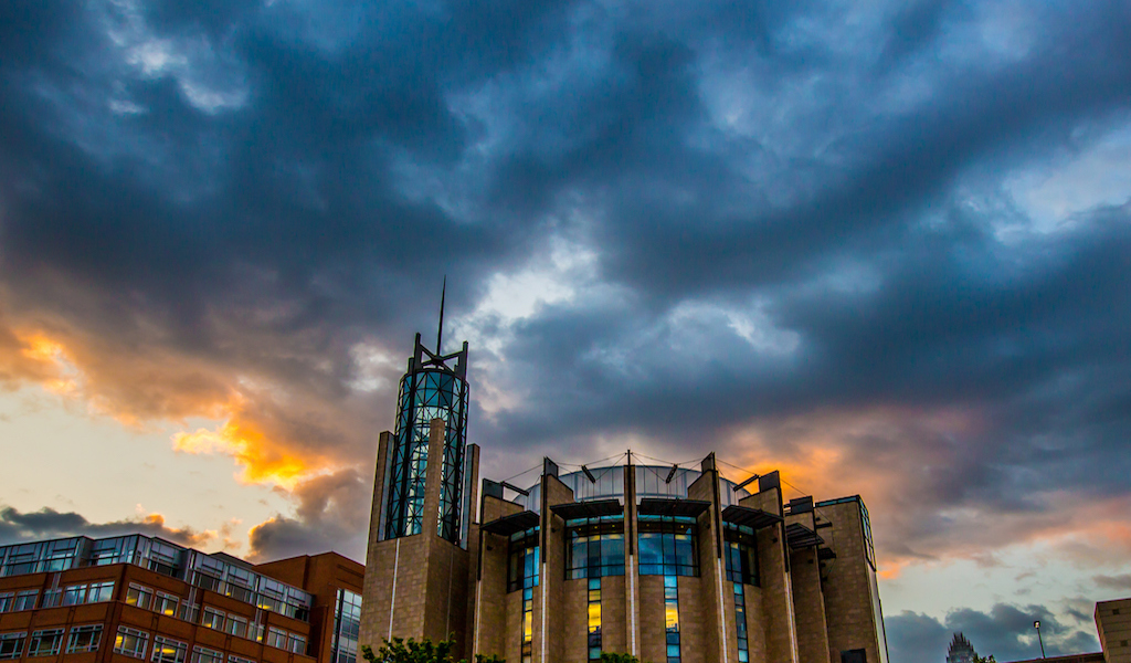Charlotte academic building beneath clouds